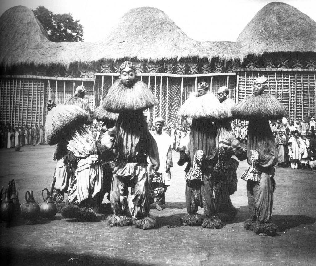 "Performance of the masks during the dance patambuo, Fumban, Bamun, ca. 1912. Field-photo by Rudolf Oldenburg. Image courtesy of the Oldenburg Collection - Museum für Völkerkunde, Vienna. (published in: ""Cameroon. Art and Kings"", Lorenz Homberger (editor), Zürich: Museum Rietberg Zürich, 2008:57, fig. 34)"