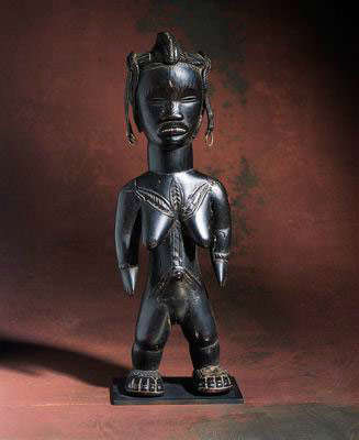 Female figure. Dan people, Cote d'Ivoire  Late 19th - early 20th century. Wood, leather, metal. H: 40 cm. Gift of Faith-dorian and Martin Wright, New York, to American Friends of the Israel Museum, in memory of Abraham Janoff. (# B92.1591) Courtesy Israel Museum, Jerusalem.