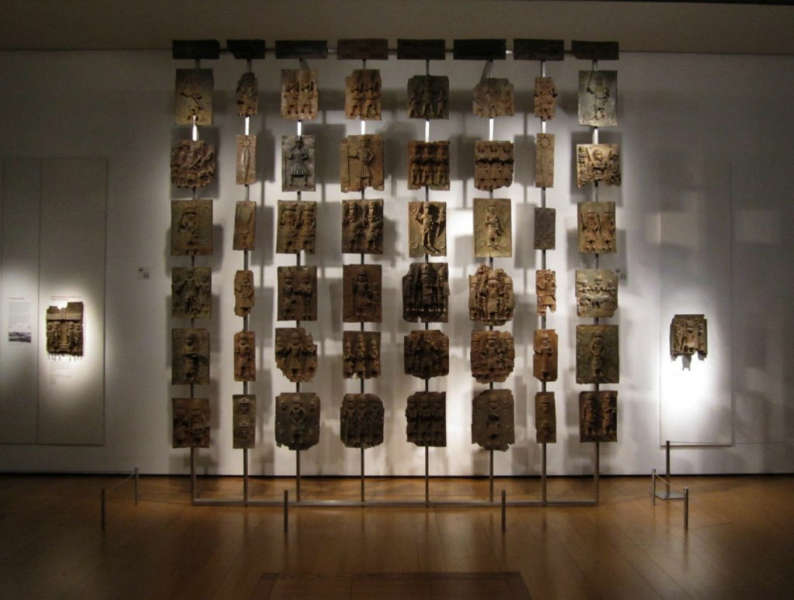A whole wall of magnificent Benin plaques at the British Museum, London. Image: BC.