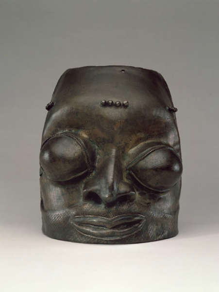 """Bulgy Eyes"" (head) Bronze. H: 26.2 cm.  Thickness of bronze: 1-2.5 mm. Found in Benin City, Yoruba Culture. Probably 16th century. Ex  Webster 6366; Ex collection Lt.  Gen. Augustus Henry Lane Fox Pitt Rivers, DCL., FRS., FSA, Farnham, Dorset. Image courtesy of George Ortiz Collection."