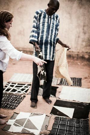 Rebecca Hoyes, of Habitat, and designer Boubacar Doumbla make cushions in Mali. Image courtesy of the Financial Times.