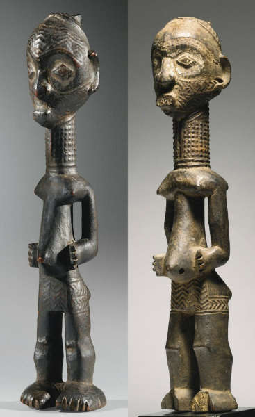 Luluwa figures from the workshop of the diamond shaped eyes. Height (left): 36 cm. Height (right): 37,5 cm. Image courtesy of Sotheby's.