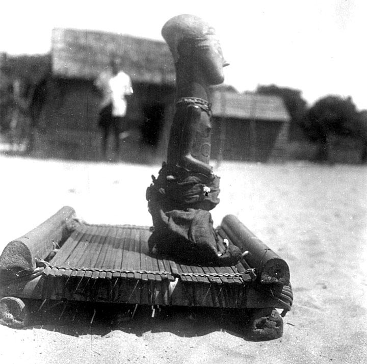 Although figure carving is not generally associated with the Kuba-Shoowas, the practice of carving a representation of the village female chieftain such as this is common throughout Shoowa groups. These are comparable to Kuba-Bsuhong royal figures (ndop). Photo by Jan Vansina, 1956. Image courtesy of the University of Wisconsin.