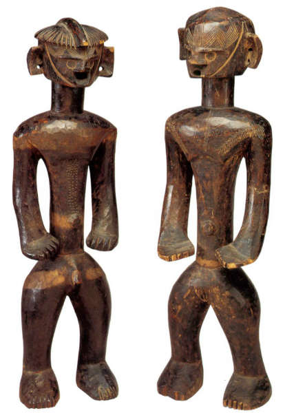 Angas figures. Height: 53,3 & 55,9 cm. Image courtesy of the Fine Arts Museum of San Francisco, The de Young Museum, San Francisco, CA., USA (#1996.12.34.1 & 2).