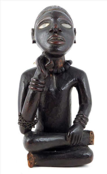 A seated Yombe figure. Height: 30 cm. Provenance: John Vernon - Putney, November 1964 & Ernst Ohly, Berkeley Galleries, London. Image courtesy of Woolley & Wallis.