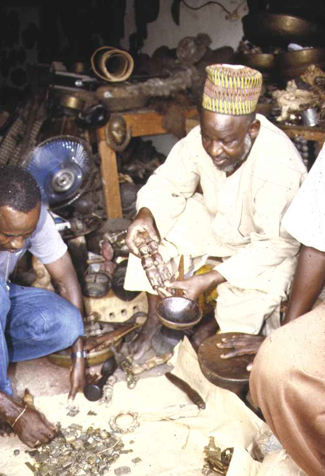 Hausa traders bargaining in a storehouse. Treichville quarter, Abidjan, June 1991. Image courtesy of Christopher Steiner (p. 67, fig. 16).