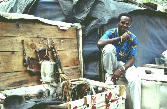 Hausa trader with wooden trunk in the back section of the Plateau market place, Abidjan, May 1988. Image courtesy of Christopher Steiner (p. 135, fig. 29).