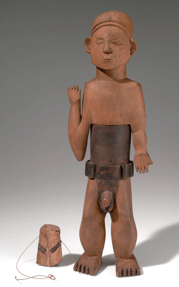 Mangbetu bark box. Height: 33,2 cm. Collected before 1915 by Herbert Lang. Image courtesy of the American Museum of Natural History (#90.1/2221). Expedition field note: NAISO. Carved figure imitating a saluting messenger of white men, the exaggeration of the cartridge belt and the sexual portion is rather a hint at the behavior of these men. They always carry a cartridge belt and also an old muzzle loader. They are never provided with powder or cartridges, but as a rule they behave very arrogant in the absence of white men and often profit of the charms so easily offered by the MANGBETU women. These figures are considered simply funny. The MANGBETU have no idols, though they firmly believe in bad spirits on the road, in the forest, in case of death of any of their chiefs they change the site of their villages.
