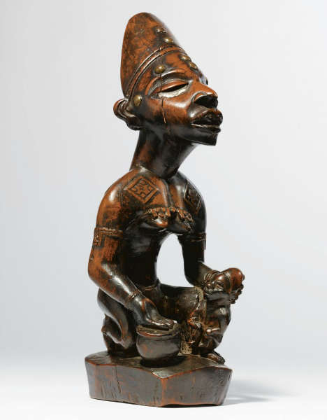 Yombe maternity figure. Height: 28 cm. Image courtesy of Sotheby's.