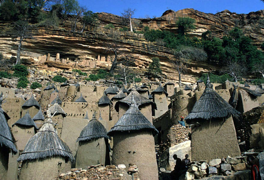 "The Dogon build four types of granaries: two for the men, and two for the women. The most common type is the square guyo ya (female) granary. There the wife keeps her personal belongings. For some special harvest, the women use a less common round granary (guyo totori). The man of the compound has at least one high granary, the guyo ana (male), with two levels inside, for the storage of millet and sorghum. The second male type of granary, the guyo togu (shelter) serves as a dwelling for a very old man."" [Hollyman S. and Van Beek W., 2001: Dogon, Africa's People of the Cliffs. Harry N Abrams, Inc.]. During his trip to Mali, Elisofon visited the Dogon people in Sanga (Sangha), a group of thirteen villages lying east of Bandiagara at the top of an escarpment. The most important villages are Ogol-du-Haut and Ogol-du-Bas. This photograph was taken when Eliot Elisofon was on assignment for National Geographic and traveled to Africa from January 19, 1972 to mid April 1972. Image courtesy of the Smithsonian Institution, National Museum of African Art, Washington."