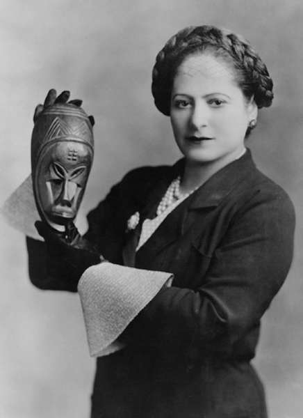 Helena Rubinstein with African mask, c. 1935. Image courtesy of the Helena Rubinstein Foundation archive, Fashion Institute of Technology, State University of New York, Special Collections. Photograph by George Maillard Kesslere.