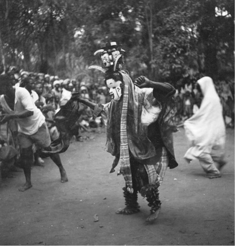 An okoroshi masquerade featuring the character of Onyejuwe. Photo by G. I. Jones, 1930s, at Eziama Orlu (Isuama Igbo).